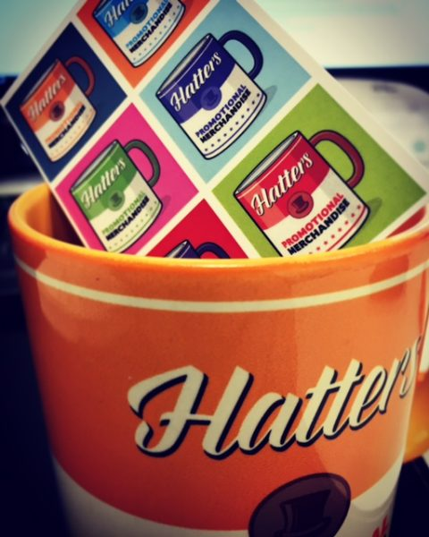 Hatters cup business card
